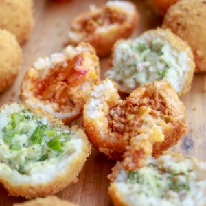 multiple arancini with different fillings in the middle